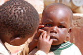 African children in Tanzania while you cleanse your face — Stock Photo