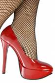 Red Shoes and fishnet stockings — Stock Photo
