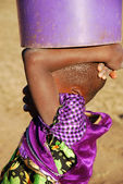 The bucket of water - Pomerini - Tanzania - Africa — Stock Photo
