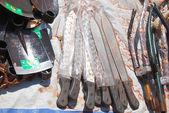 Among shovels, machetes and pieces of bike in market of Pomerini — Stock Photo