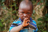 I look at him full of questions of an African child — Stock Photo