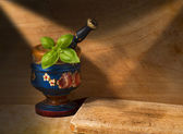 Old Wooden Mortar with Basil — Stock Photo