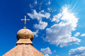 Bronze Cross on Blue Sky — Stock Photo