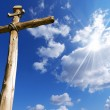 Wooden Cross Against a Blue Sky — Stock Photo #57305573