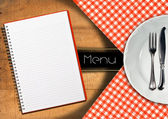 Menu with Notebook and White Plate — Stock Photo