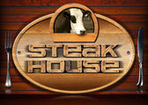 Steak House - Sign with Cow and Cutlery — Stock Photo