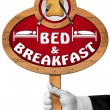 Bed and Breakfast - Sign with Hand of a Concierge — Stock Photo #78520006