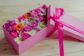 Colorful flowers in box — Stock Photo