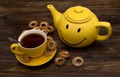 Yellow kettle and cup — Stock Photo