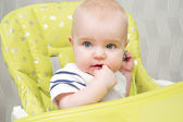 Baby in highchair — Stock Photo