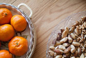 Nuts and citrus — Stock Photo