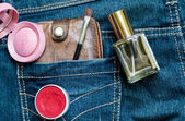 Jeans, cash and lipstick — Stock Photo