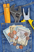 Money and tool in jeans pocket — ストック写真