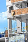 Crane hoisting formwork — Fotografia Stock