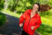 Woman athlete running in summer park — Stock Photo