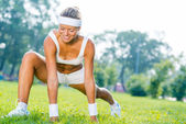 Fitness girl stretching in park — Stok fotoğraf