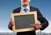 Businessman with frame — Stock fotografie