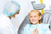 Dentist inspecting patient — Stock Photo