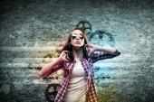 Teenager girl in shirt wearing headphones — Foto Stock