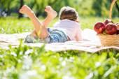 Little girl lying in summer park — Stock Photo