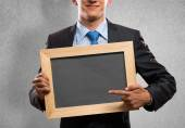 Businessman with frame — Foto Stock
