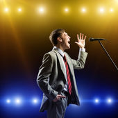 Businessman with microphone — Stock Photo