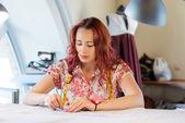 Seamstress woman at work — Stock Photo