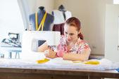 Seamstress at work — Stock Photo