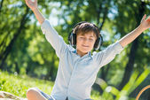 Boy enjoying music — Stock Photo