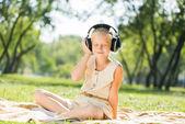 Girl enjoying music — Stock Photo