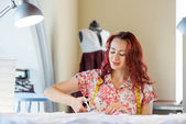 Tailor woman at work — Stock Photo