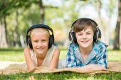 Kids wearing headphones — Stock Photo