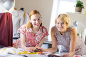 Two sempstress at work — Stock Photo