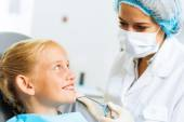 Dentist inspecting patient — Stock Photo