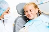 Dentist inspecting patient — Stockfoto