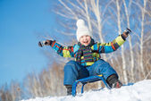 Little cute boy riding sled — Stock Photo