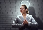 Young Praying businesswoman — Stock Photo