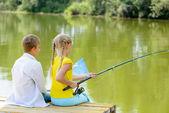 Boy and girl fishing — Stock Photo
