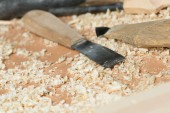 Carpenter's tools lying among sawdust — Stock Photo