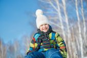Little cute boy riding sled — Stock Photo