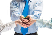 Unity of businesspeople - Sprout in hands — Stock Photo