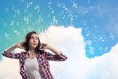 Teenager girl in headphones — Stock Photo