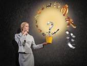 Businesswoman holding bucket with currency signs — Stock Photo