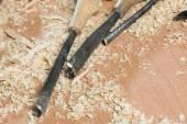 Carpenter's tools lying among sawdust — Stock Photo