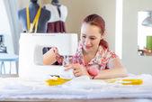 Young Seamstress at work — Stock Photo