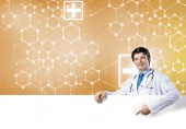 Doctor with banner — Stock Photo