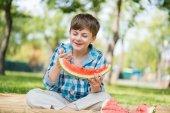 Cute boy eating juicy watermelon — Foto de Stock