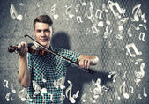 Man violinist in casual — Stock Photo