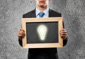 Businessman with frame light bulb — Stock Photo