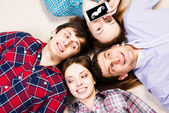 Four people lie together — Stock Photo